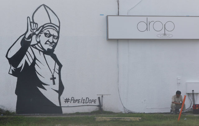 Guam Tumon painting Pope is Dope on side of building.