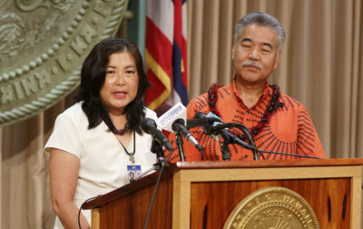 Financial Institutions Commissioner Iris Ikeda discusses the Colorado based credit union and the cashless marijuana sales system with Governor David Ige at presser in the govs office.