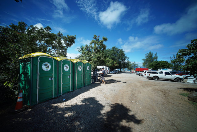 Portable toilets sit in the parking lot across Sharks Cove in Pupukea.