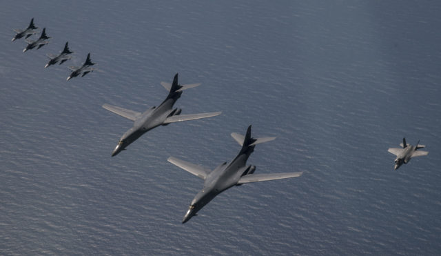 This Sept. 17, 2017 photo provided by the U.S. Air Force shows U.S. Air Force B-1B Lancers, U.S. Marine Corps F-35B Lightning IIs and Japan Air Self-Defense Force F-2 fighters flying in formation during a show of force mission north of Japan. The U.S. Air Force's top commander in the Asia-Pacific region said his troops haven't changed the way they operate in response to North Korea's assertion that it would have the right to shoot down U.S. bombers even in international airspace. (Mike Karnes/U.S. Air Force via AP)