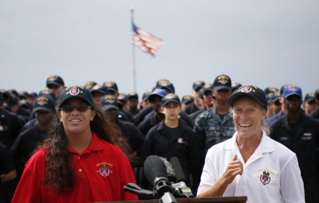 Jennifer Appel, right, and Tasha Fuiava speak on the deck of the USS Ashland at White Beach Naval Facility in Okinawa, Japan Monday, Oct. 30, 2017. The U.S. Navy ship arrived at the American Navy base, five days after it picked up the women and their two dogs from their storm-damaged sailboat, 900 miles southeast of Japan. (AP Photo/Koji Ueda)