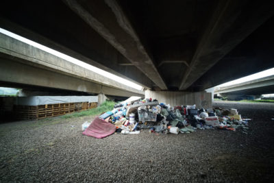Airport viaduct homeless garbage.