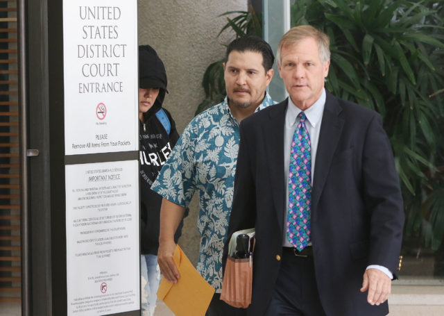 Derek Hahn with attorney Birney Bervar leave US District Court.