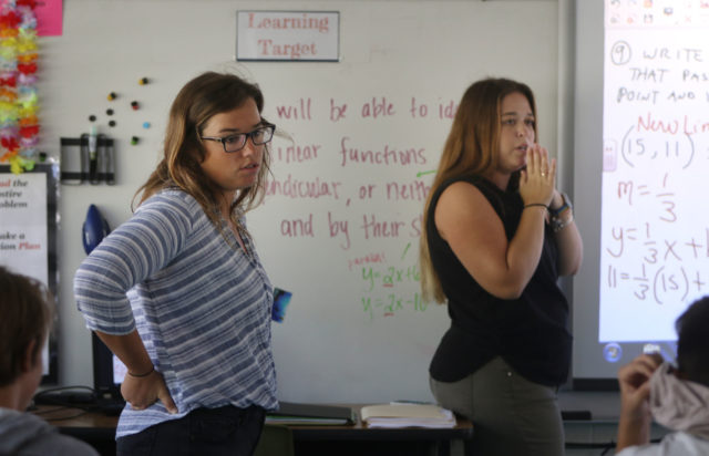 Kailua Middle School Math Teachers Ms Parent and Nicole Shirk in their classroom teaching.