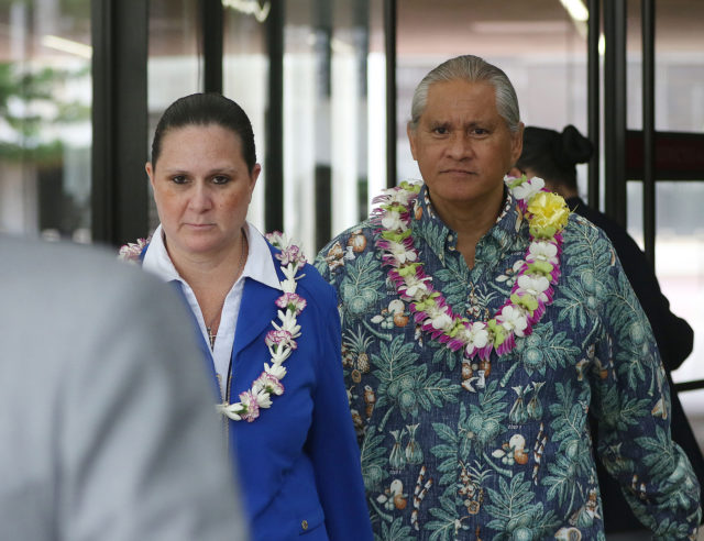 Retired HPD Chief Louis Kealoha and wife Katherine Kealoha walk out the exit at US District Court.