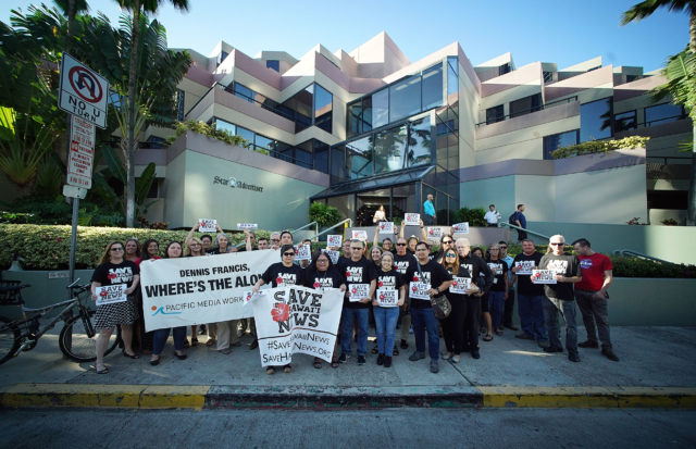 Honolulu Star Advertiser staffers and supporters rally holding signs 'Save Our News' outside their offices located at Restaurant Row.