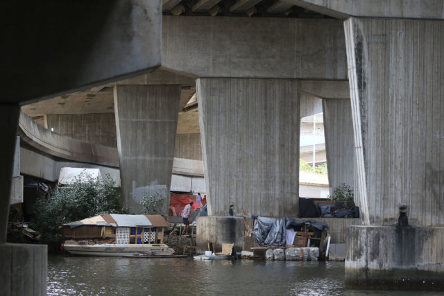 Structures under Nimitz viaduct with structures and other water craft.