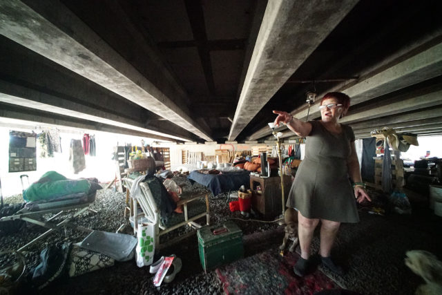 Michelle Brown stands under the Nimitz viaduct and give us a tour of her large living area. She says she has been under the viaduct over 20 years.