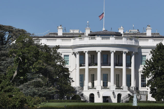White House Washington DC with US flag lowered to half staff after the US deadliest shooting in modern history.