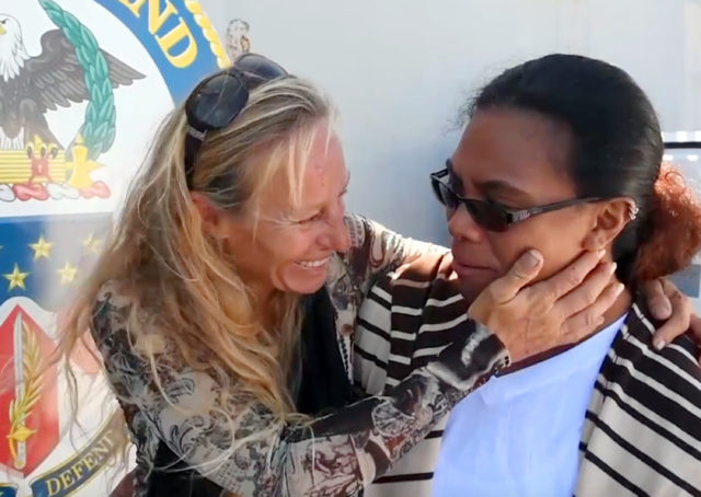 In this Wednesday, Oct. 25, 2017 frame from video provided by the U.S. Navy, Jennifer Appel, left, and Tasha Fuiava, who with their dogs were rescued after being lost at sea for several months while trying to sail from Hawaii to Tahiti, are interviewed aboard the USS Ashland in the South Pacific Ocean. The U.S. Navy rescued the women on Wednesday after a Taiwanese fishing vessel spotted them about 900 miles southeast of Japan on Tuesday and alerted the U.S. Coast Guard. The women lost their engine in bad weather in late May, but believed they could still reach Tahiti. (Mass Communication Specialist 3rd Class Jonathan Clay/U.S. Navy via AP)