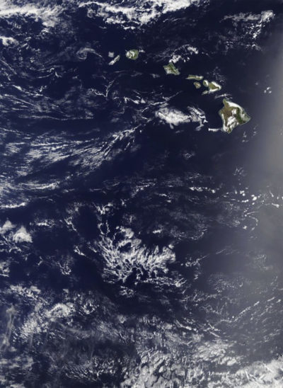 "In this May 3, 2017, satellite image provided by NASA, the Pacific Ocean around Hawaii is shown. Two Honolulu women who set off to sail the South Pacidic on their 50-foot sailboat the Sea Nymph left the state on May 3 and ran into trouble almost immediately. They say they encountered a violent ""Force 11"" tropical storm just off the shores of Hawaii on their first night, a storm that lasted for three days. The National Weather Service in Honolulu says no organized storm systems were in the area at the time, and this NASA satellite image shows no major tropical depressions in the region on May 3. (NASA via AP)"