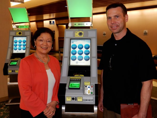 U.S. Sen. Mazie Hirono and US Customs and Border Protection official Kevin Kealoha McAleenan pose together in April 2016 to celebrate arrival of machines that will make it easier for foreign tourists to get to their destinations in Hawaii