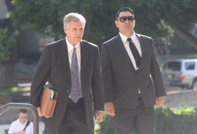 Derek Wayne Hahn arrives with attorney at District Court. Kealoha Case.