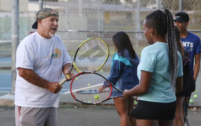 Kalihi Tennis Coach Jerry Watson coaches at Kalihi District Park.