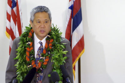 File - In this May 4, 2017 file photo, House Speaker Scott Saiki talks to reporters in Honolulu. Conflicts of interest are scattered around at the Hawaii State Legislature, where many lawmakers work outside jobs. Bills that could benefit or harm lawmakers' sources of income often come up. Lawmakers argue there are good reasons for voting even in such circumstances. Saiki said lawmakers have a duty to represent their constituents, which includes voting. (AP Photo/Cathy Bussewitz, File)