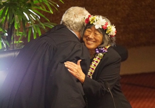 Chief Supreme Court justice Mark E. Recktenwald hugs Rep Lei Learmont after oath.