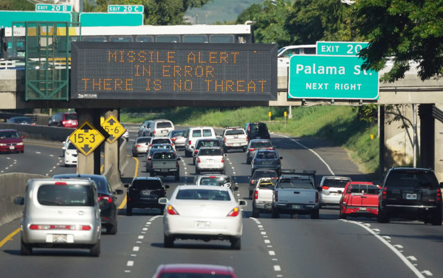 Missile alert in error no threat reads the sign located on the Liliha Street overpass.