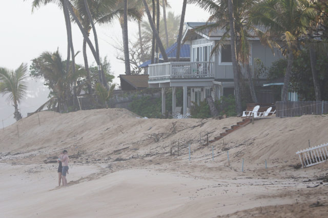 Sunset Beach sand burm protection fronting homes.