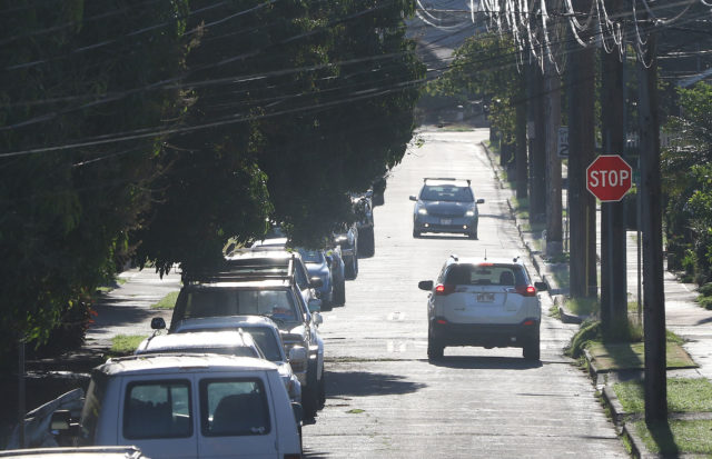 Coyne Street in McCully with parked cars along the mauka side and usually congested. Cars driving on the mauka side with parked cars usually yield to oncoming cars.