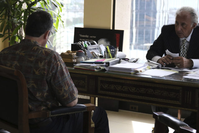 Honolulu attorney Michael Green, right, sits with his client, the former Hawaii Emergency Management Agency employee who sent a false missile alert to residents and visitors in Hawaii, left, during an interview with reporters, Friday, Feb. 2, 2018 in Honolulu. The ex-state employee says he's devastated about causing panic, but he believed it was a real attack at the time. The man in his 50s spoke to reporters Friday on the condition he not be identified because he fears for his safety after receiving threats. (AP Photo/Jennifer Sinco Kelleher)