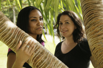 FILE - In this Dec. 19, 2011 file photo, Taeko Bufford, left, and Diane Cervelli, right, pose for a photo near Waikiki beach in Honolulu. A Hawaii appeals court has ruled against a Hawaii bed and breakfast that denied two women a room because they're gay. The Intermediate Court of Appeals affirmed a lower ruling against Aloha Bed & Breakfast, whose owner appealed based on her religious views. (AP Photo/Eric Risberg, File)