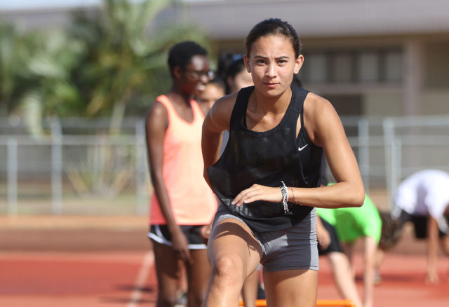 Campbell HS track runner, Leilani Leopard a junior practices on the field. The female athletes don't have a girls locker room to change in before practice.