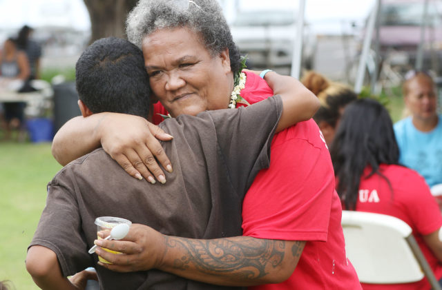 Aunty Twinkle Borge receives a hug during open house held at Puuhonua O Waianae/Waianae Boat Harbor.