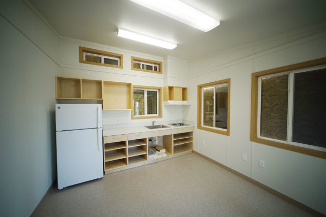 85 248 Farrington Road City developed housing 1 bedroom unit, with kitchen area.