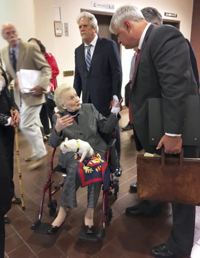 Abigail Kawananakoa, a 91-year-old Hawaiian heiress, talks with her attorney Michael Rudy as they leave a Honolulu courtroom Thursday, March 15, 2018. A judge has ruled that allegations that the heiress' wife, Veronica Gail Worth, physically abused Kawananakoa require further investigation. Thursday's ruling came in the ongoing legal fight for control over Kawananakoa's $215 million trust. Many Native Hawaiians consider her to be the last Hawaiian princess because of her lineage. (AP Photo/Jennifer Sinco Kelleher)