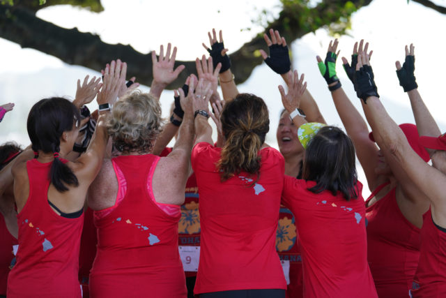 Twelve of us from the kettlebell workout group from Johnny's Fitness Ohana jubilate with high fives after completing the Guiness World Record attempt at Magic Island.