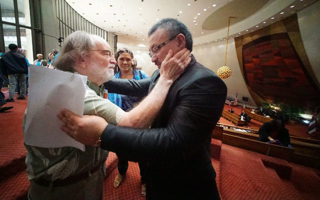 Chair Mizuno embraces Gov Neil Abercrombie after House passed death with dignity measure.