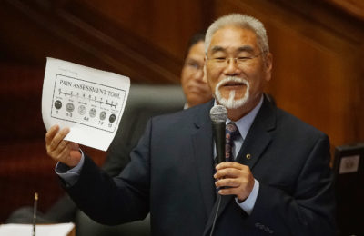 Rep Sam Kong opposition to death bill during floor debate holds up his pain assessment tool. Rep Kong spoke about how much pain he is in everyday.