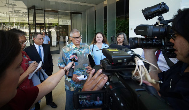 Retired HPD Chief Louis Kealoha gives a short statement to the media after exiting District Court.