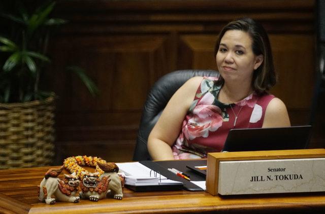 Senator Jill Tokuda sits at her desk during floor session.