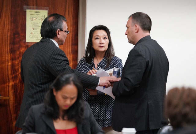 Chair John Mizuno and right, Sen Josh Green speak to Rep Sylvia Luke during recess of a conference committee in the Capitol room 325 1030a meeting.