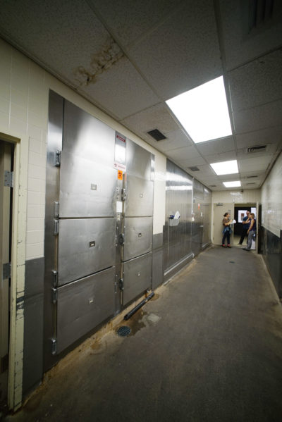 Medical Examiner tour refrigerators with bodies inside. The morgue can hold over 50 bodies.