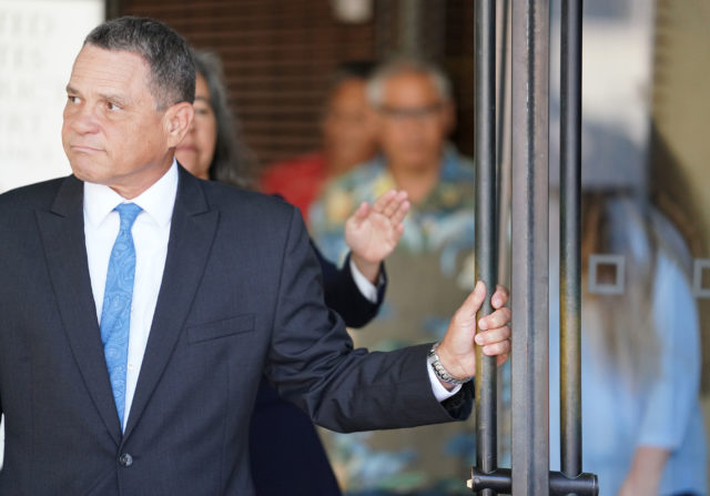 Retired HPD Chief Kealoha attorney Rustam Barbee opens door ahead of Louis Kealoha at District Court.