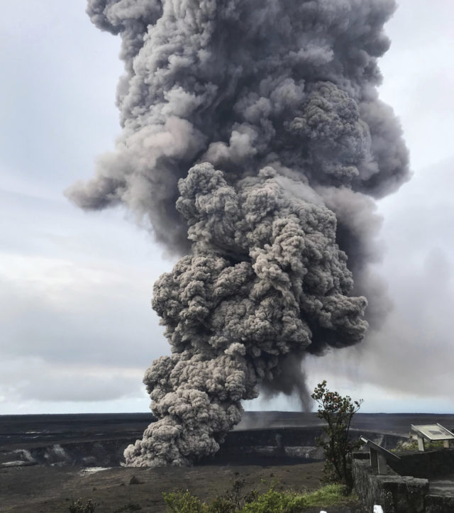 In this Wednesday, May 9, 2018 photo, an ash column rises from the crater at the summit of Kilauea volcano at Volcanoes National Park, Hawaii. Scientists said Wednesday the risks of an explosive summit eruption will rise in coming weeks as magma drains down the flank of the volcano toward the area lava started erupting from fissures in a residential neighborhood last week. (U.S. Geological Survey via AP)