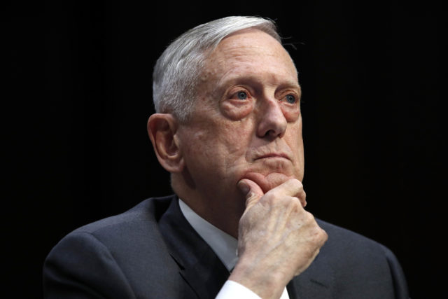 FILE - In this April 26, 2018, file photo, Defense Secretary Jim Mattis listens to a question during a hearing on Capitol Hill in Washington. Mattis says the U.S. will continue to confront China's militarization of manmade islands in the South China Sea, arguing that Beijing hasn't abided by its promise not to put weapons on the Spratly Islands. (AP Photo/Jacquelyn Martin, File)