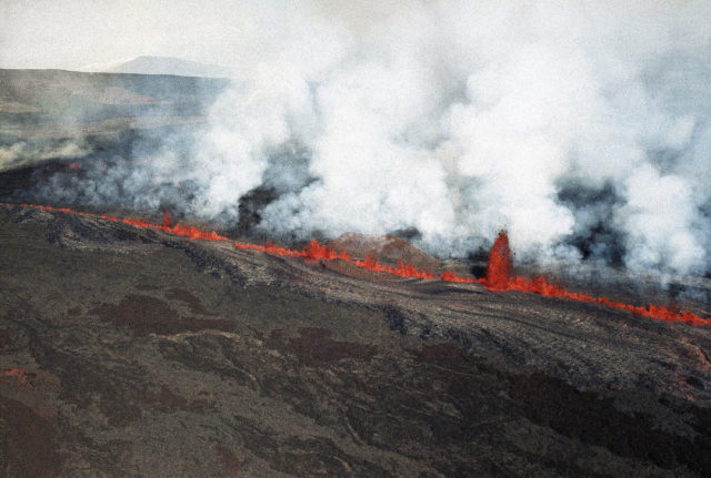 FILE - In this March 25, 1984, file photo, lava erupts along Mauna Loa volcano in Hawaii. Hawaii's Kilauea volcano has captivated people around the world by shooting lava high into the sky and sending rivers of molten rock pouring down hillsides into the ocean over the past month, but it's only one of many volcanoes in the islands. (AP Photo/Ira Schwarz, File)