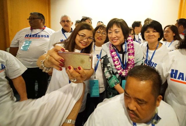 Congresswoman Colleen Hanabusa with supporters making selfies at the 2018 Hawaii Democratic Convention held at the Hilton Waikaloa Hotel in Kona, Hawaii.