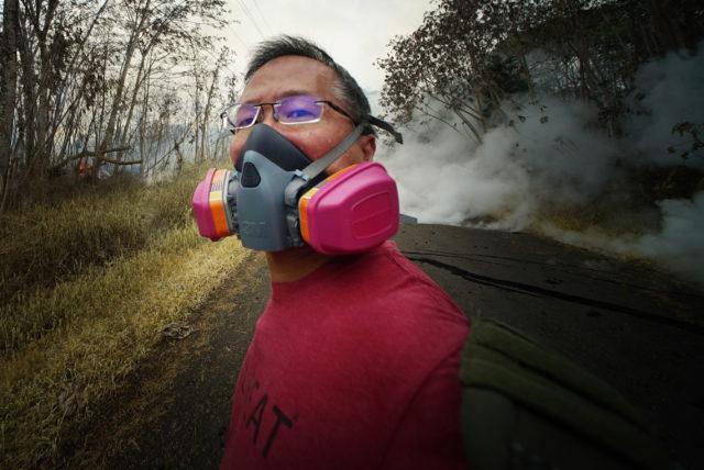Cory Lum covering Kahukai Street in Leilani Estates Volcano LAva.