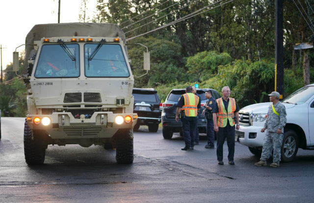 National Guard vehicle on Leilani Avenue, turns onto Highway 130 Pahoa Kalapana Road.