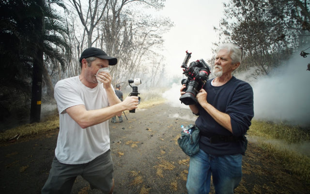 Left, Tim Coakley films right, Leilani estates resident and volcano photographer Mick Kalber along Kahukai Street. 13th eruption. Puna, Hawaii.