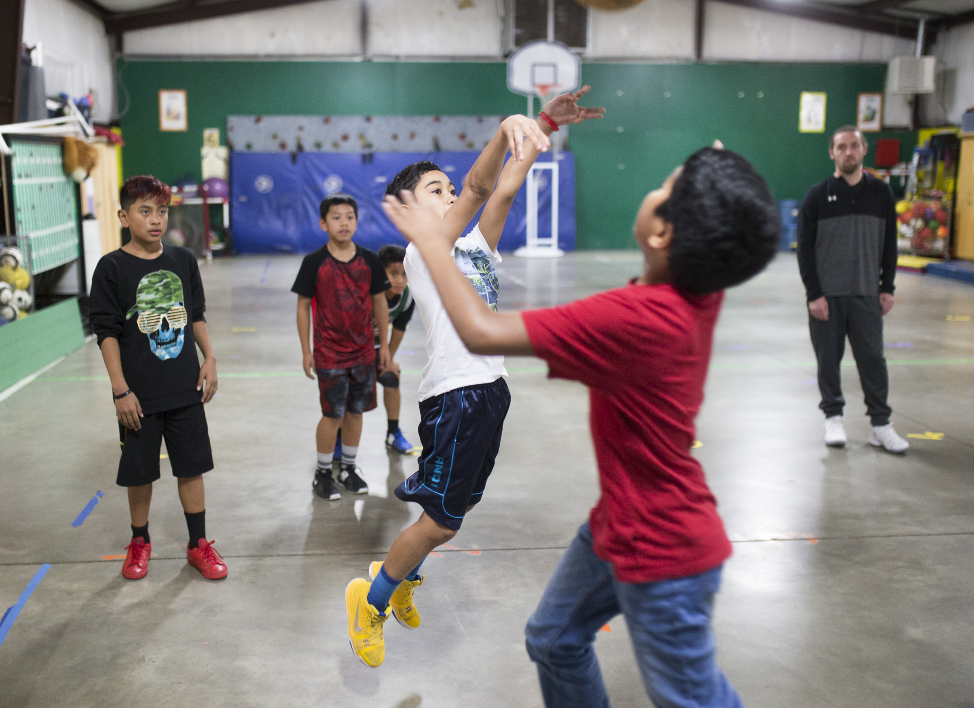 Daniel Juda 10 shoots a basket during a program called Language and Layups at Robert E. Lee Elementary School in Springdale, February 14, 2018.