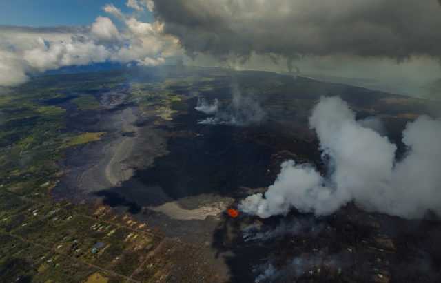 Fissure 8 continues to blast fresh lava several hundred feet in the air and flow towards Kapoho as the Kilauea Volcano lower east rift zone eruption continues on Wednesday, June 6, 2018, in Pahoa, Hawaii. (AP Photo/LE Baskow)