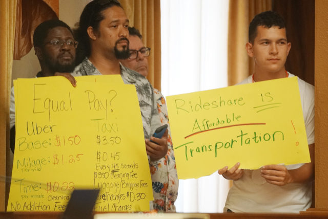 Bill 35 Rideshare Supporters Opposition signs at the Honolulu City Council today.