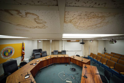 Honolulu Hale, Honolulu City Council Committee room with stains from water leaks on roof panels.