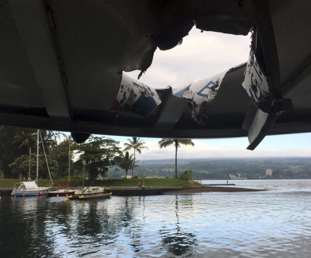 FILE - This photo provided by the Hawaii Department of Land and Natural Resources shows damage to the roof of a tour boat after an explosion sent lava flying through the roof off the Big Island of Hawaii, Monday, July 16, 2018, injuring at least 23 people. The lava came from the Kilauea volcano, which has been erupting from a rural residential area since early May. (Hawaii Department of Land and Natural Resources via AP, File)