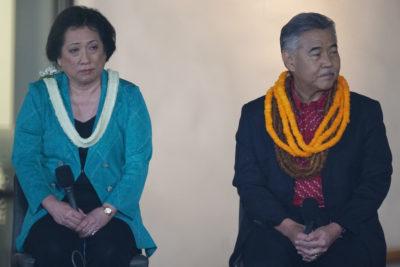 Gubernatorial Candidates Colleen Hanabusa Gov David Ige debate sit while Mahealani asks about the false missile alert.
